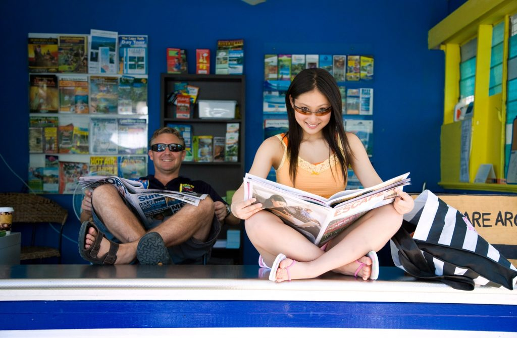 Saaya is reading newspaper
